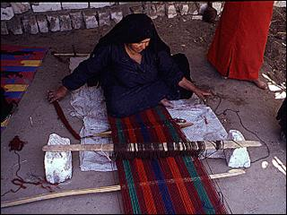 settled nomad weaving a piece